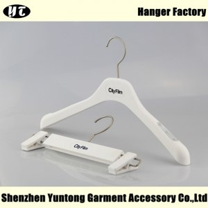 White rubberized plastic clothes hanger for shirt and coat
